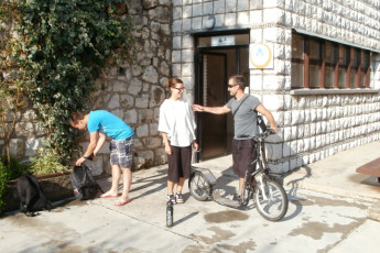 Dubrovnik : Youth Hostel Dubrovnik guests about to ride a scooter outside the front of the hostel