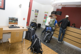 YHA London St Pancras : YHA St Pancras guests arriving at the hostel reception