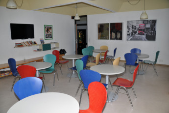 Innsbruck -  Reichenauerstrasse : Communal seating in hostel with entertainment such as television