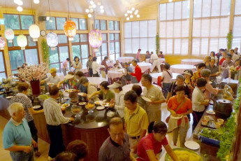 Xitou Youth Activity Centre : Xitou Youth Activity Centre hostel canteen with self-serve buffet and people getting food, aerial view