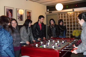 Barcelona - Ideal Youth Hostel : guests playing table football at Ideal Youth Hostel