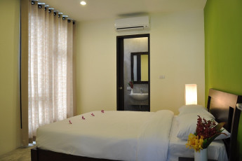 HI Udee Bangkok : HI Udee Bangkok, double room, large window, green and white decor, minimal design with open door showing the private bathroom