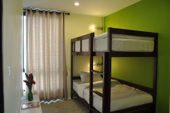 HI Udee Bangkok : HI Udee Bangkok, twin room with green and white decor, minimal design, bunk beds and a large window