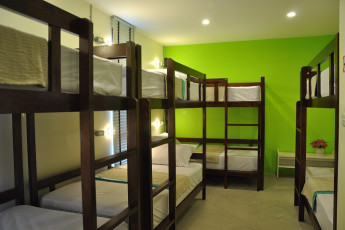 HI Udee Bangkok : HI Udee Bangkok dorm room decorated in green and white, bunk beds,
