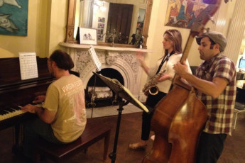 HI - Baltimore : Musicians playing in lounge of HI Baltimore Hostel