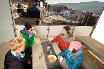 Åre Torg : Guests socialising on terrace area of the Are Torg hostel in Sweden