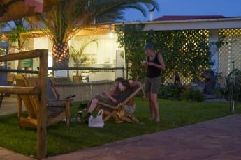 Windhoek - Chameleon Backpackers : Group relaxing in the gardens of the Windhoek - Chameleon Backpackers hostel in Namibia