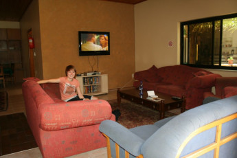 Windhoek - Chameleon Backpackers : Person in the lounge of the Windhoek - Chameleon Backpackers hostel in Namibia