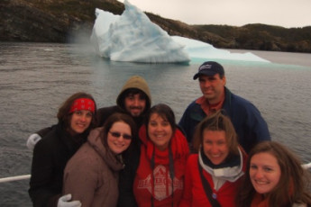 HI - Trinity East : Group of guests and iceberg near HI - Trinity East hostel in Canada