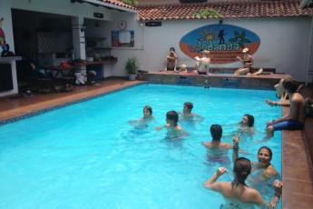 Santa Cruz - HI Hostel Jodanga : People in the Pool Area at Santa Cruz - HI Hostel Jodanga