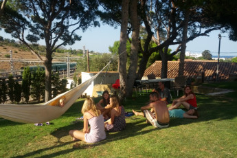 Llançà - Costa Brava : Group of guests in gardens of Llanca - Costa Brava Hostel in Spain