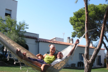 Llançà - Costa Brava : Guests relaxing in the gardens at the Llanca - Costa Brava Hostel in Spain