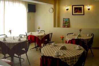 Iquitos - Ambassador : Dining room in the Iquitos - Ambassador hostel in Peru