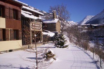Lanslebourg - Val Cenis : Exterior view of building in snow at the Lanslebourg/Val Cenis hostel in France