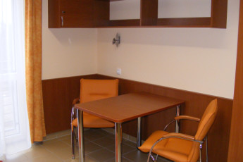 Debrecen - OEC West Hostel : Seating Area in Single Bedroom in Debrecen - OEC West Hostel