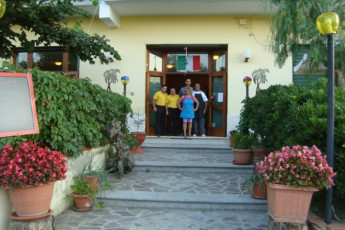 Guardavalle Marina - YH Borgorosso : Staff by the entrance to the Guardavalle Marina - YH Borgorosso hostel in Italy