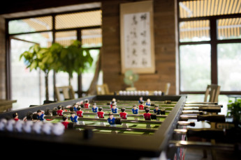 Hangzhou - The Green International YH : Footbal table in lounge of Hangzhou - The Green International Hostel in China