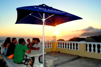 Myoli Beach - Afrovibe Adventure Lodge : People Relaxing on the Patio at Myoli Beach - Afrovibe Adventure Lodge Hostel, South Africa