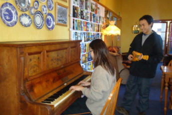 YHA Westport : Playing the Piano at Westport, Tripinn, New Zealand