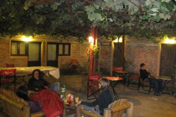 La Paloma - Hostel Ibirapitá : People Socialising on the Patio of La Paloma - Hostel Ibirapita, Uruguay