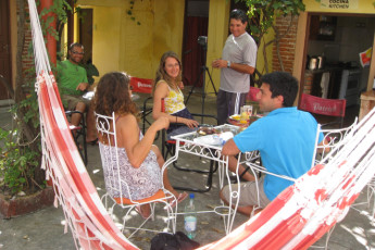 La Paloma - Hostel Ibirapitá : People Dining on the Patio of La Paloma - Hostel Ibirapita, Uruguay