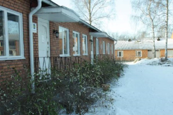 Falun : Front Exterior View of Falun Hostel, Sweden in the Snow