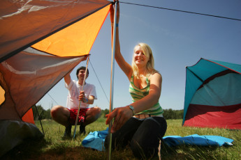 Prora mit Zeltplatz : People Setting up a Camping Tent at Prora - Youth Hostel Prora, Germany