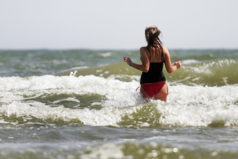 Prora mit Zeltplatz : Person Having a Dip in the Sea by Prora - Youth Hostel Prora, Germany
