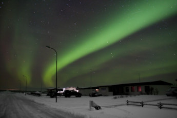 Kópasker : Exterior View of Kopasker Hostel, Iceland During the Snow Under the Northern Lights