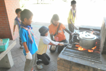 Osaka - Osaka International YH : Cooking on the Patio at Osaka - Osaka International Youth Hostel, Japan at Night