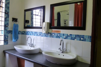 Durban - Gibela Backpackers Lodge : Basins in Communal Bathrooms at Durban - Gibela Backpackers Lodge Hostel, South Africa