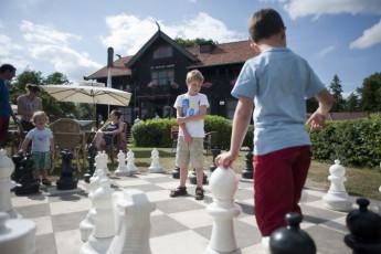 Stayokay Gorssel : Children Playing Chess in the Garden at Stayokay Gorssel Hostel, Netherlands