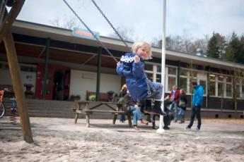 Stayokay Apeldoorn : Little Girl Playing on the Swings at Stayokay Apeldoorn Hostel, Netherlands