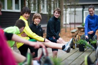Stayokay Apeldoorn : Teenagers Stretching on the Patio at Stayokay Apeldoorn Hostel, Netherlands