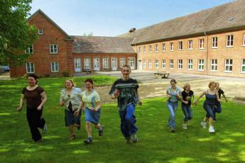 Wismar : Guests Playing Outside Wismar Hostel, Germany