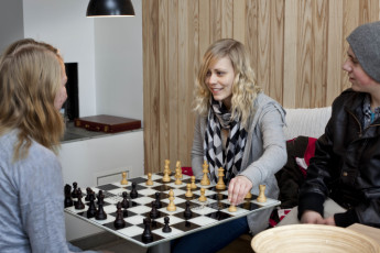 Lillehammer : Guests playing chess in the Lillehammer hostel in Norway