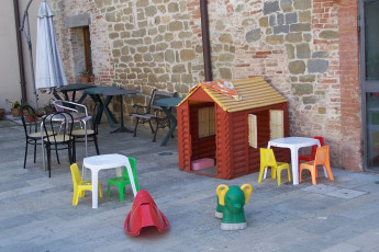 Perugia - Villa Giardino Y.H. : Patio and Children's Play Area at Perugia - Villa Giardino Youth Hostel, Italy