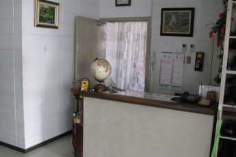 Okinawa - City Front Harumi YH : Reception Desk in Okinawa - City Front Harumi Youth Hostel, Japan