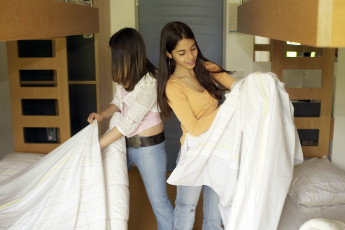 Lultzhausen : Guests Fixing Their Bed Covers in the Dorm Room at Lultzhausen Hostel, Luxembourg