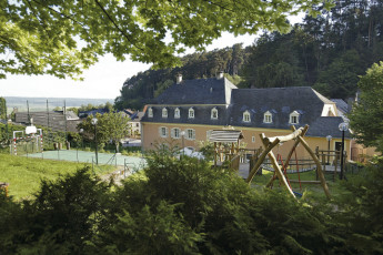 Bourglinster : Garden, Football Short, Playground and Exterior View of Bourglinster Hostel, Luxembourg
