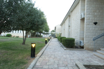 Tel - Hai : Exterior pathways at the Tel - Hai hostel in Israel