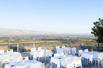 Tel - Hai : Dining terrace at the Tel - Hai hostel in Israel