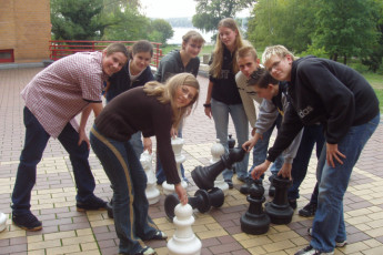 Berlin - JH am Wannsee : Guests playing outdoor chess at the Berlin - JH am Wannsee Hostel in Germany
