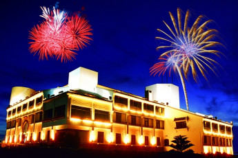 Penghu - YAC International Youth Hostel : Exterior View of Penghu - YAC International Youth Hostel, Taiwan at Night During a Firework Display