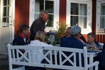 Stora Frögården : Waiter Serving Food to Guests on Patio at Stora Frogarden Hostel, Sweden
