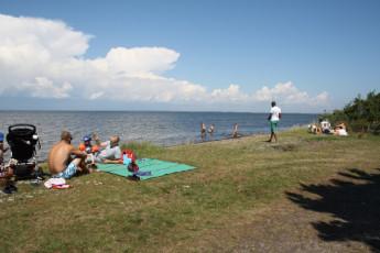 Stora Frögården : Guests Relaxing at the Beach Local to Stora Frogarden Hostel, Sweden