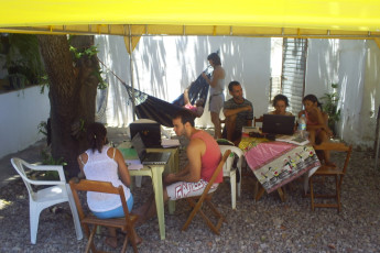 Chapada Diamantina – Palmeiras – Caminhos Da Chapada : Guests Relaxing on the Patio at Caminhos da Chapada Hostel, Brazil