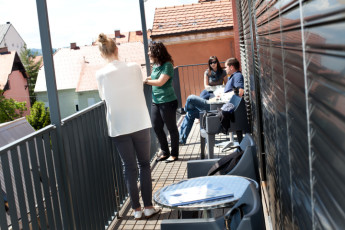 Youth Hostel Pekarna : Guests Relaxing on the Balcony at Maribor - Youth Hostel Pekarna, Slovenia