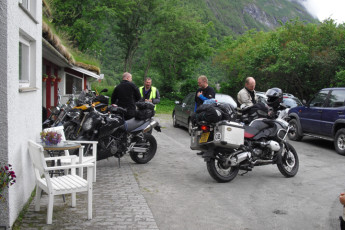 Åndalsnes : Guests Standing Outside Andalsnes Hostel, Norway With Their Motorcycles