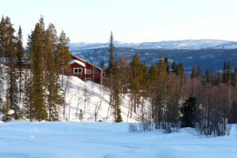 Kvikkjokk Mountain Station : Exterior View of Lappland - Kvikkjokk Mountain Lodge Hostel, Sweden During the Snow